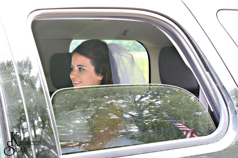 June wedding bride in car