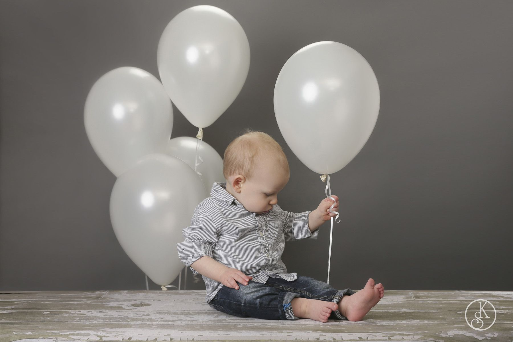 boy in studio with balloons