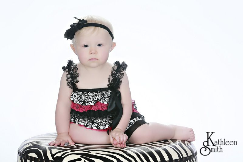 Studio baby girl on zebra stool
