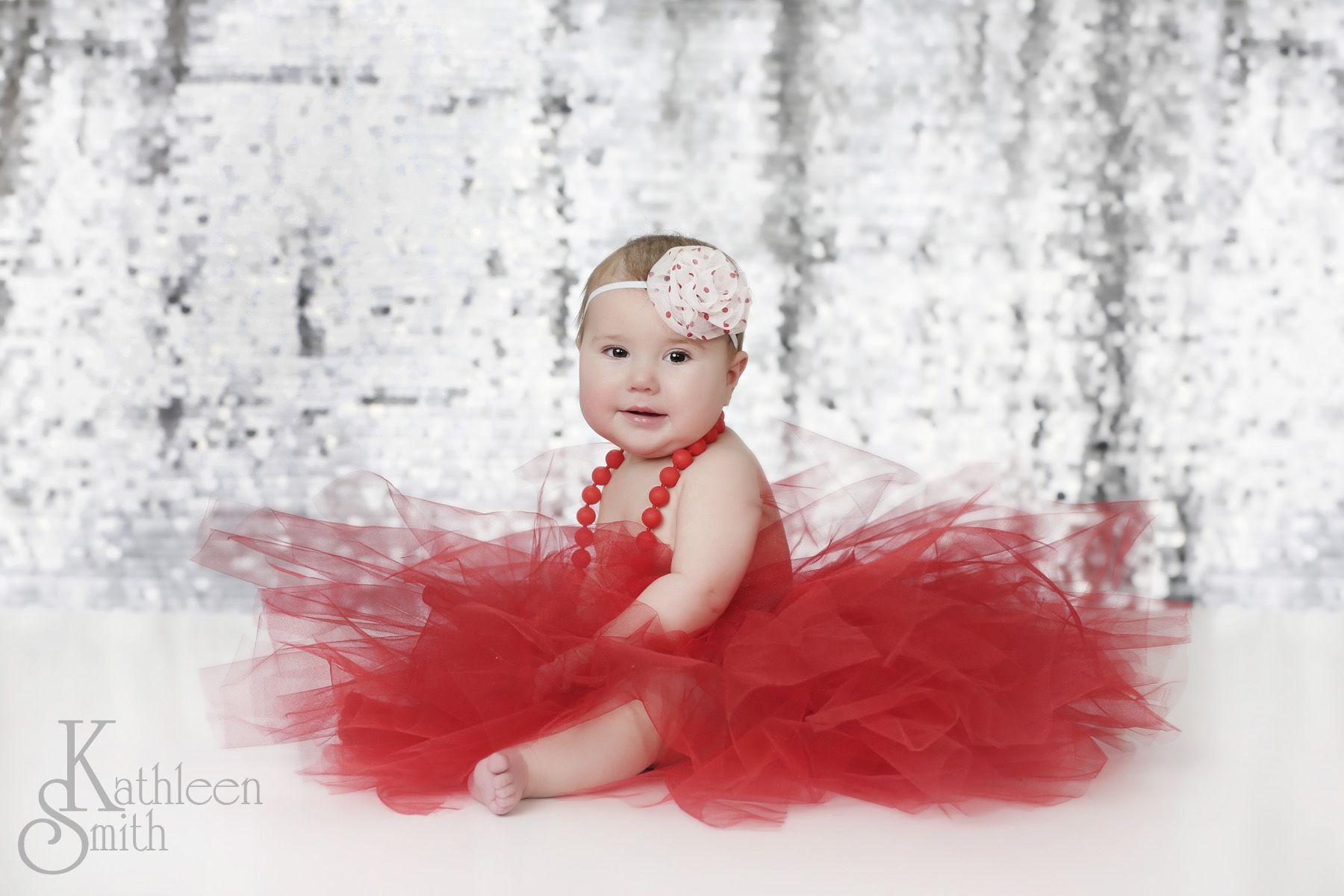 Baby girl in red tutu