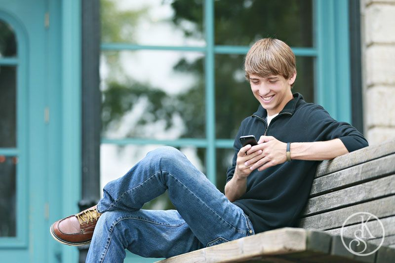 high school graduate on location texting