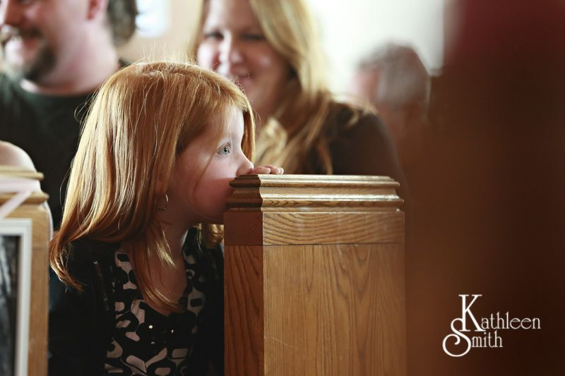 little girl watching bride come down the aisle