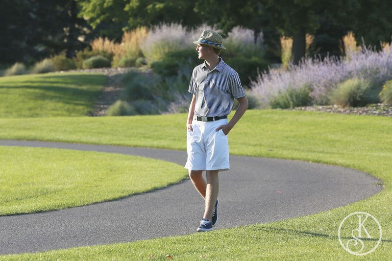 high school graduate on location walking on golf course