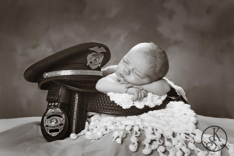 newborn in studio police equipment