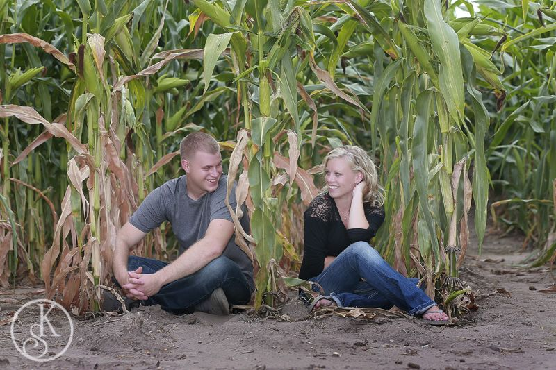 engagement couple in corn field