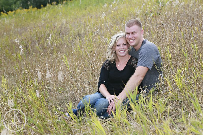 engagement couple in field