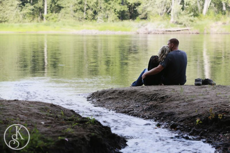 engagement couple on river bank