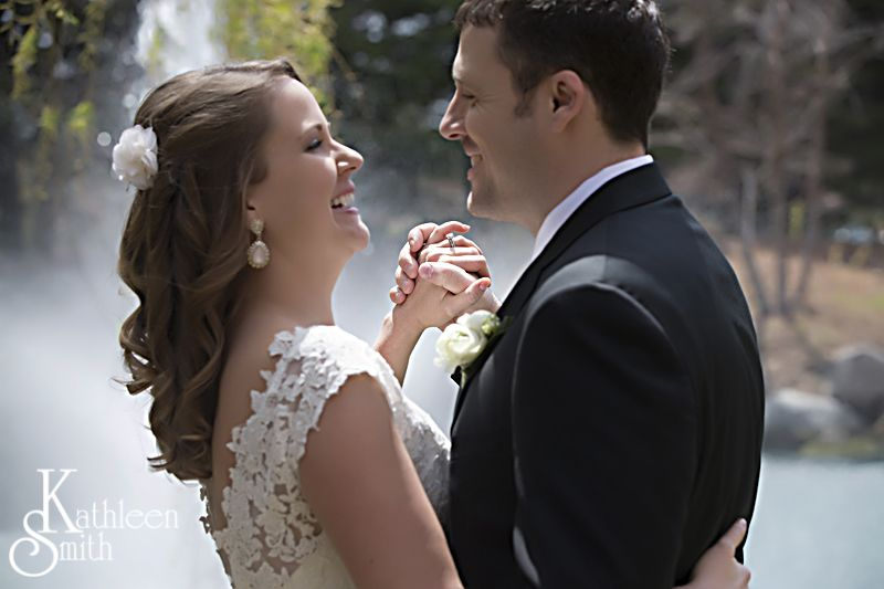 Bride and groom showing ring detail