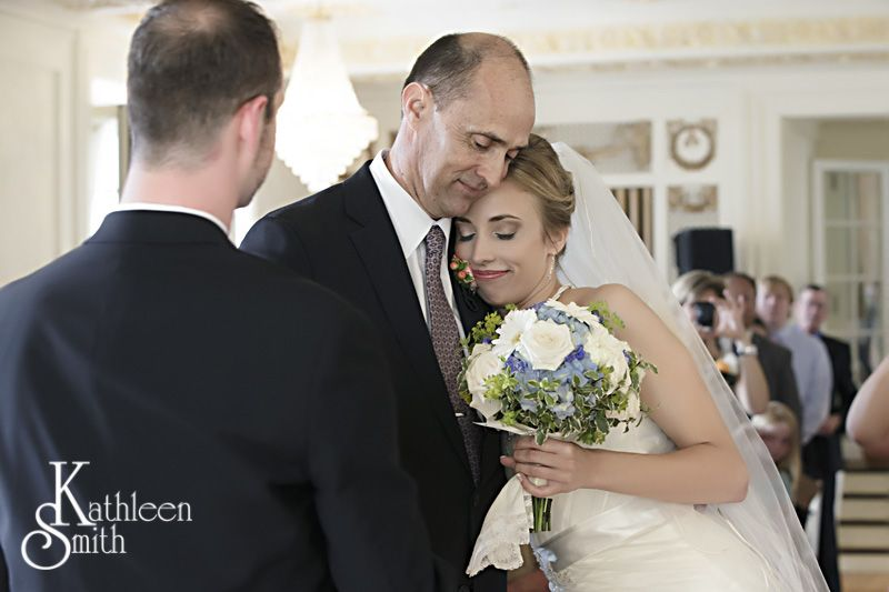 Father hugging daughter at wedding ceremony