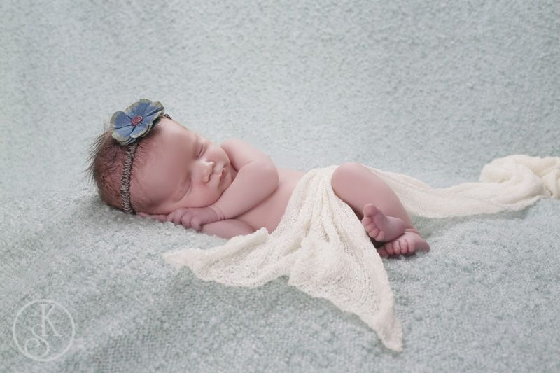 newborn on aqua in studio