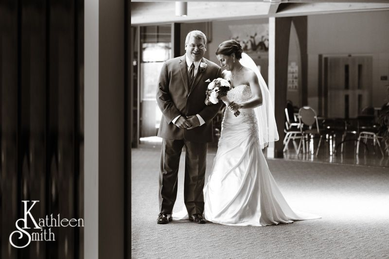 Father and daughter walking down aisle